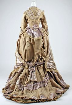 Dress: ca. 1865-1870, French (probably), silk, lace. I Love the way it comes together in the back with a bow.