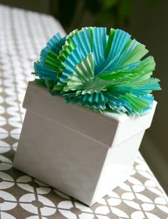 Liner Bows  Use cupcake liners to make a pretty pom for the top of a gift. Visit the how-to at Family Chic.