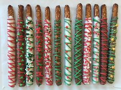 Christmas Chocolate Covered Pretzel Rods, Individually wrapped with a bow, tree, star, gingerbread man, candy cane, holly, peppermint, Dipped Pretzel Rods, Chocolate Covered Treats, Chocolate Covered Pretzel Rods, Chocolate Dipped Pretzels, Pretzel Sticks, Christmas Pretzels, Christmas Deserts, Christmas Chocolate, Christmas Candy
