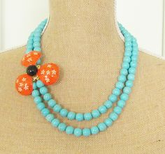 Vintage Enamel Flower Necklace Tangerine Orange and Black Painted Flower Double Strand Turquoise Howlite Beaded Statement Necklace OOAK. via Etsy.