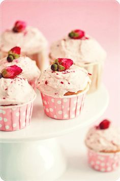 Sweetly gorgeous little raspberry cupcakes with cream cheese frosting in pink polka dot cupcake wrappers. So cute! #cupcakes #baking #food #dessert #pink #cute #polkadots #raspberries #wedding #roses