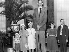 Robert Wadlow of Alton, Illinois, the world's tallest man ever at 8 feet, 11.1 inches tall, is seen with his family in 1939 ~ Photo from the Detroit News Archives©
