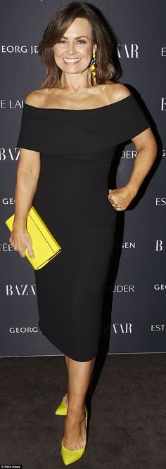 Pops of colour: Lisa Wilkinson wore a black dress with yellow accessories including shoes,...