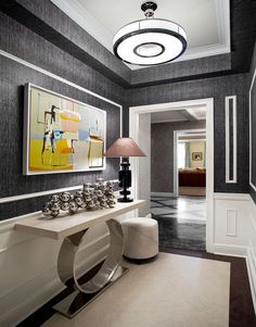 Contemporary Hallway with Pendant Light, Wainscoting, Concrete floors, Ceiling molding, Howard elliot aquarius console table