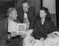 Victor Fleming, Leslie Howard & Vivien Leigh. I have that same cover for my copy :) One of my most favorite books!