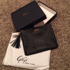 Gigi clutch NEW IN BOX Brand new in box with original dust cover and care instructions. Gorgeous black leather in reptile design. GiGi New York Bags