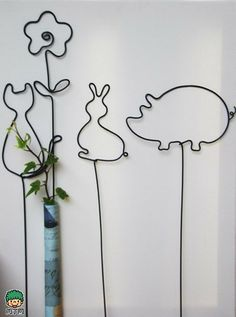 Cartoon critters rust wire line vase to create a garden groceries