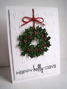 "Stamped several times as close to looking like a wreath as possible and then cut out around outside and in the middle.  Stamp 5 or 6 more hollies and cut out.  Adhere all around the already stamped ""wreath"" and then dot the berries with red liquid pearls.  Place on holly embossed panel and adhere to card."