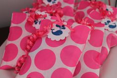 Pink and Navy blue whale birthday party- Love the polka dots with the curly ribbon.