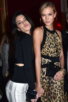 Kendall Jenner gave her best duck-face pose while holding hands with pal Karlie Kloss at the Balmain afterparty during Paris Fashion Week on Thursday.