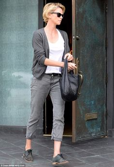 Glamorous even off the red carpet: On Friday Charlize Theron looked perfectly put together in her casual wear as she exited a photo shoot in LA
