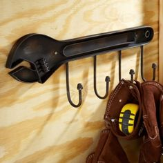 Manly Man Wrench Coat Rack, from GreatGiftsforMen.com Only $28.95     The perfect gift for the Do-it-Yourselfer      Features a unique manly wrench shape      Makes a welcomed addition to most any man cave, shop, or your garage      Measures 20.5'' x 7''