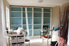 DIY bookcase  - four white bookshelves and moulding =built in book shelves. DAMN now why didn't I think of that.