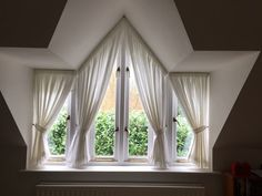 Lovely apex window with voile by Tara Charlton Curtains