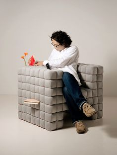"""""""Lost in sofa"""", by Japanese designer Daisuke Motogi created this comfy chair that can hold all your books, remotes, gadgets and other small objects in the cracks between its soft blocks - MY kind of chair! Sofa Design, Furniture Design, Sofa Chair, Couch Cushions, Cool Chairs, Lost & Found, Minimal Design, Herman Miller, Home And Living"""