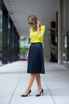 Pair a neutral accordion skirt with a bright cardigan for a classy look.