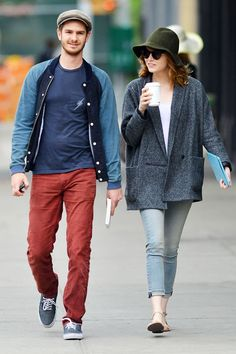 Emma went for an incognito look during an early summer stroll with the boyfriend, attempting to hide her fiery tresses under a floppy hat. But, her Rag