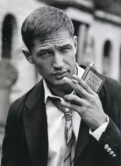 Suit. Cig. Book flask. Love me some Tom Hardy.