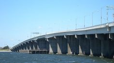 The Cross Bay Veterans Memorial Bridge (originally Cross Bay Bridge or Cross Bay Parkway Bridge) in New York City, is a toll bridge that carries Cross Bay Boulevard from Broad Channel in Jamaica Bay to the Rockaway Peninsula, and is located in Queens.