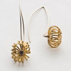 Pistachios. Daisy earrings with black cz inside, on curved out wire with curved in back wire, sterling silver gold plated.