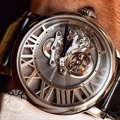 The astounding Cartier Rotonde de Cartier Cadran Lové Tourbillon. A 46mm 18k white gold case housing a flying tourbillon which has been remade to display the keyless works, gear train and barrel on the front.LiveFeed