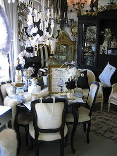 "Vignettes Antiques created the ultimate voyeur's view into CHANEL's famous apartment above her Paris salon at 31 Rue de Cambon with a lavishly appointed scene ~ ""Dinner With Coco"" Vintage, white fox fur runner (6 feet long!) down the centre of the table."