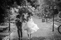 "Rainy Wedding Photos: Having an outdoor wedding shoot doesn't mean that you will always have sunny photos in the nearby park. You'll often get ""less desirable"" atmospheric conditions. However, don't let that get you down! Embrace it and play along."