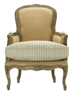 ...a salute to the classic French Bergere chair...the carved frame, jute burlap wrap, nailhead trim and seat cushion outfitted in a vintaged ticking stripe.