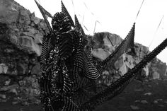 Nightmarish figures made from old VHS tapes wander in frozen I...