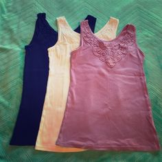 Ribbed Tank Bundle - Navy, White, Mauve 3 Size M ribbed tank tops with a woven embellishment detail at the collar - 95% cotton, 5% spandex - perfect with a pair of shorts alone or under a cardigan at work - barely worn New York & Company Tops Tank Tops