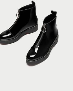 Image 6 of FLAT FAUX PATENT ANKLE BOOTS WITH TAB from Zara