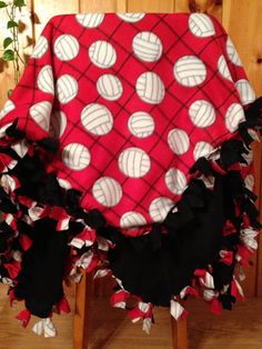 Handmade hand tied fleece red volleyball print blanket/throw. Back is a solid black fleece. Super soft. Measures 59x52. All borders are hand tied. **Other colors available** All blankets are made with high quality anti pill fleece. Machine washable. Tumble dry on low or air dry. GREAT GIFT IDEA!! ** We are able to order many different fleece fabrics so if you dont see what you are looking for dont be afraid to ask! :) **