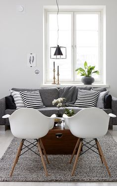 Lovely Living room with fantastic white chairs and a comfy grey couch.