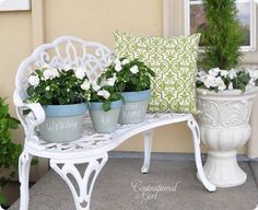 "Love the white iron bench and the pots that say ""welcome to our home"""