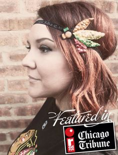 Show your cute style while cheering on the Chicago Blackhawks with this Sequined Headband interpretation of the IndianHead Feathers.    RedEye