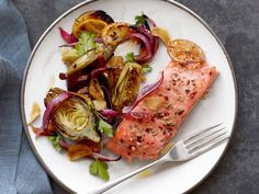 Salmon with Baby Artichokes : Garlic and crushed fennel seeds create an aromatic seasoning for these tender roasted salmon fillets. Round out the meal by serving the salmon with an elegant salad of artichokes and red onions.