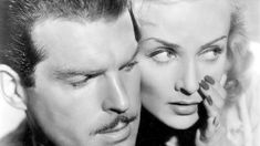 """Carole Lombard with Fred MacMurray in """"True Confession."""""""