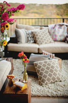 I like the idea of a low couch and a old wooden box as a coffee table with flowers everywhere. Excellent place to decompress and do some yoga.