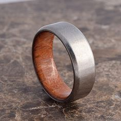 These beautiful hand made rings are made using grade 5 titanium and Jatoba, also known as Brazilian Cherry.This exotic hardwood is carefully