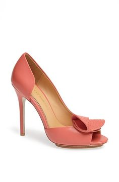 Free shipping and returns on Badgley Mischka 'Tarian' Leather Peep Toe Half d'Orsay Pump at Nordstrom.com. A perforated, origami-inspired bow accents the flirty peep toe of a graceful half d'Orsay pump cast in buttery-soft leather.