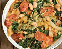 White bean ragout with kale... Used chorizo instead of vegetarian sausage, and added jalapeno-smoked bacon. Really, really good