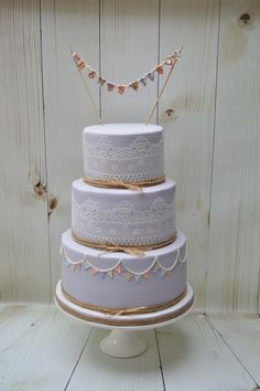 A Lavender Wedding cake with Raffia, Hessian, Sugarlace and Bunting added to our collection of 2016.