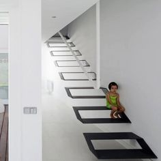 Design is playing with shapes and space to create an illusion of floating stairs. Beautiful.