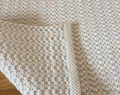 Off white cotton rug handmade on loom. Ivory and dark gray