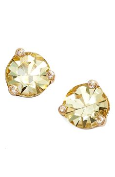 Add extra sparkle to any look with these cheerful stud earrings from Kate Spade!