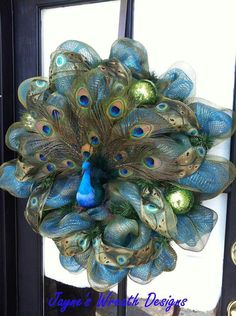 Peacock Wreath by Candy HighlandPeacock Wreath - this made me think of Jennifer Whittaker!A Peacock ChristmasMost beautiful wreath ever layed my eyes onNo tutorial, just inspiration pic Peacock Wreath, Peacock Decor, Peacock Theme, Peacock Ornaments, Peacock Christmas Tree, Peacock Crafts, Peacock Ring, Peacock Colors, Peacock Wedding