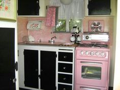 Vintage trailer renovated kitchen. All in pink- so retro!