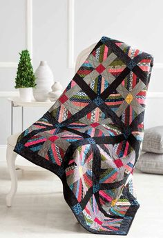 Three reasons to love string piecing: stash-buster projects, expression of personal creativity, and unmatched, unique designs. Look at some stellar string-pieced quilts and learn 3 different string piecing techniques for amazing quilts!