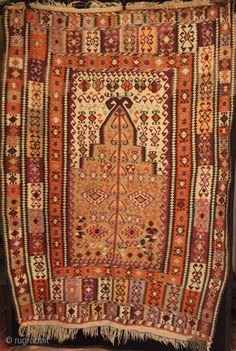 100 years old this year, a beautiful large east Anatolian Erzurum, Kars district prayer kilim from the Gumushane/Erzincan area. Fine weaving of three complex borders and intricate motifs, central tree of life and small female figure. Wool on a light natural and dark brown hand spun wool foundation, plaited guard borders. Dated 1332 in Arabic, 1915 in our calendar. Stored as a dowry kilim, so in amazingly good original condition - an exceptional example. 200cm x 145cm.