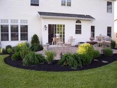 I love the look of the black mulch w/ the lush green!